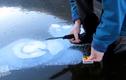 Cách đun sôi nước trên hồ đóng băng