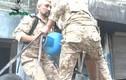 Phe nổi dậy Syria bắn bình gas vào quân chính phủ