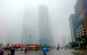 Chùm ảnh: Hà Nội chìm trong màn mưa mù rét mướt