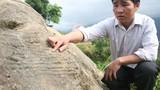 Truy tìm hình khắc lạ lùng trên đá
