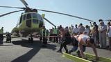 Xem người phụ nữ Nga kéo trực thăng nặng 8,6 tấn