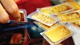 Giá vàng tăng nhỏ giọt, USD kịch trần ngày thứ 7 liên tiếp
