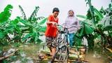 Chùm ảnh: Cuộc sống ở ốc đảo Hà Nội những ngày nước lên