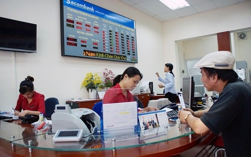 Nguyen nhan khien ngan hang Sacombank vuong no xau sieu khung?