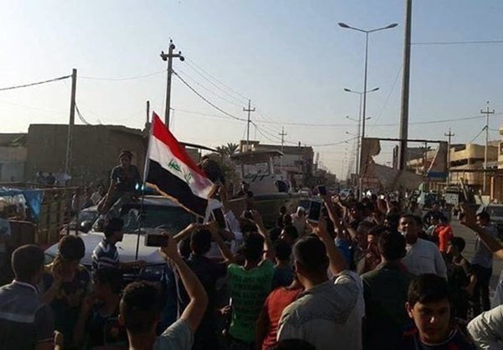 Anh: Quan doi Iraq giai phong lang mac o Anbar khoi IS-Hinh-3