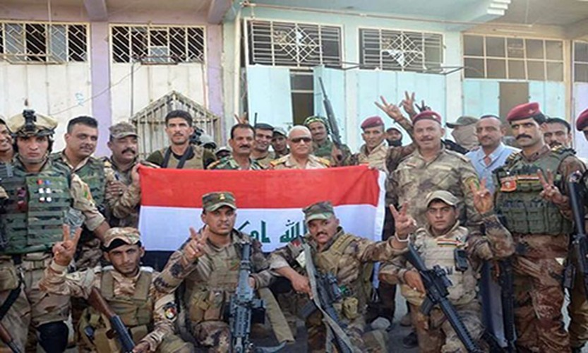 Anh: Quan doi Iraq giai phong lang mac o Anbar khoi IS-Hinh-7