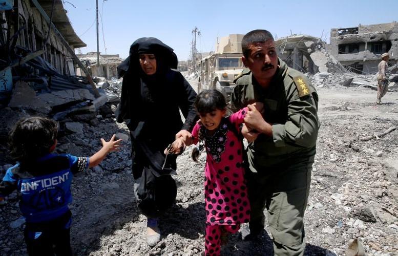 Hinh anh tre em Iraq chay khoi Tay Mosul-Hinh-7