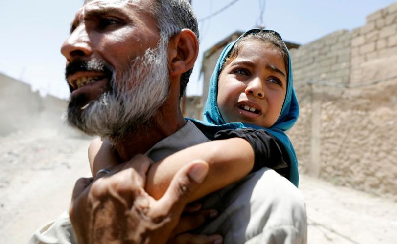 Hinh anh tre em Iraq chay khoi Tay Mosul
