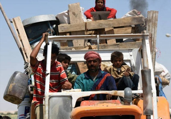 Anh: Giao tranh ac liet, thuong dan Syria lu luot roi Raqqa