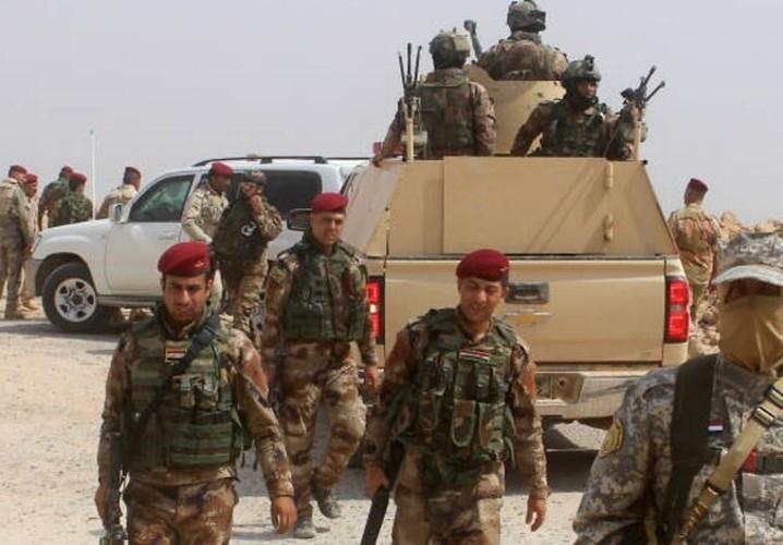 Anh: Iraq giai phong vung trong yeu gan bien gioi voi Syria-Hinh-9