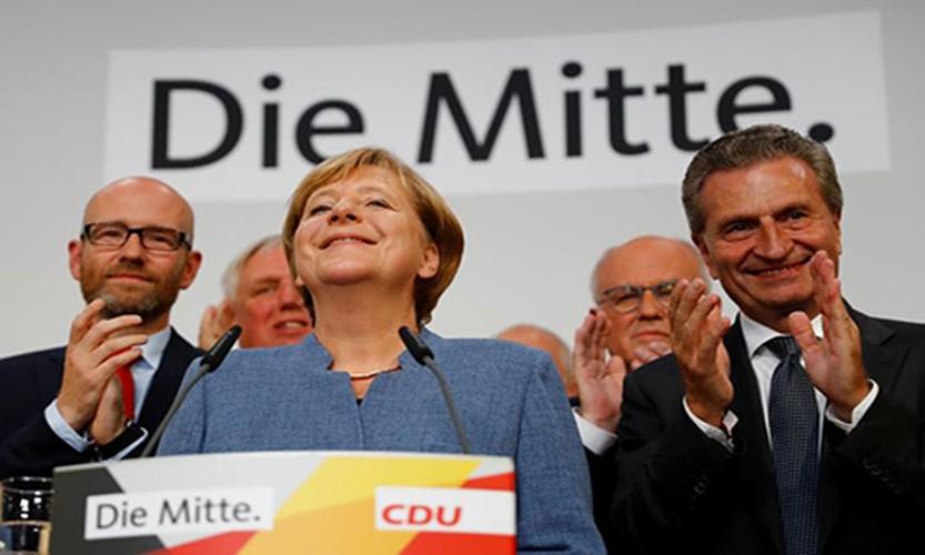 Anh: Thu tuong Merkel thang loi dang cay trong bau cu Duc