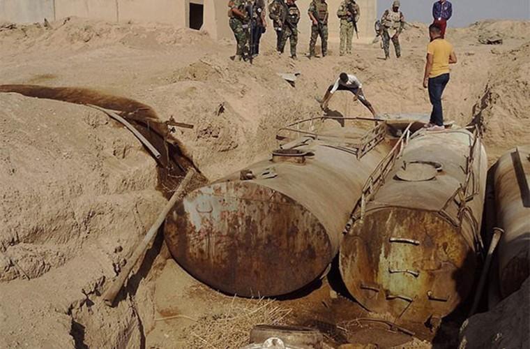 Kinh hoang ben trong ho chon tap the cua IS o Iraq-Hinh-5