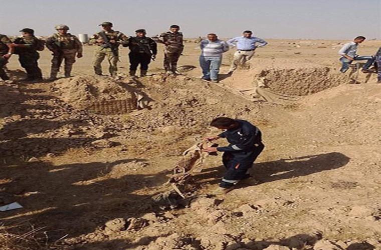 Kinh hoang ben trong ho chon tap the cua IS o Iraq-Hinh-7