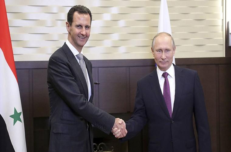 Cai bat tay chien thang cua Tong thong Putin va Tong thong Assad