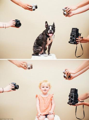 Bạt cuòi xem bé và cún cung có bieu cam giong het nhau-Hinh-2