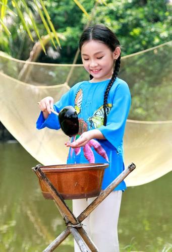 Tan chay voi ve dang yeu cua co be dan ca Nghi Dinh-Hinh-4