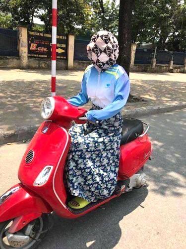 """Nguoi Ha Noi cuoi xe may chong nang 40 do nhu """"Ninja""""-Hinh-3"""