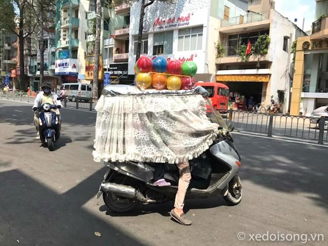 """Nguoi Ha Noi cuoi xe may chong nang 40 do nhu """"Ninja""""-Hinh-9"""